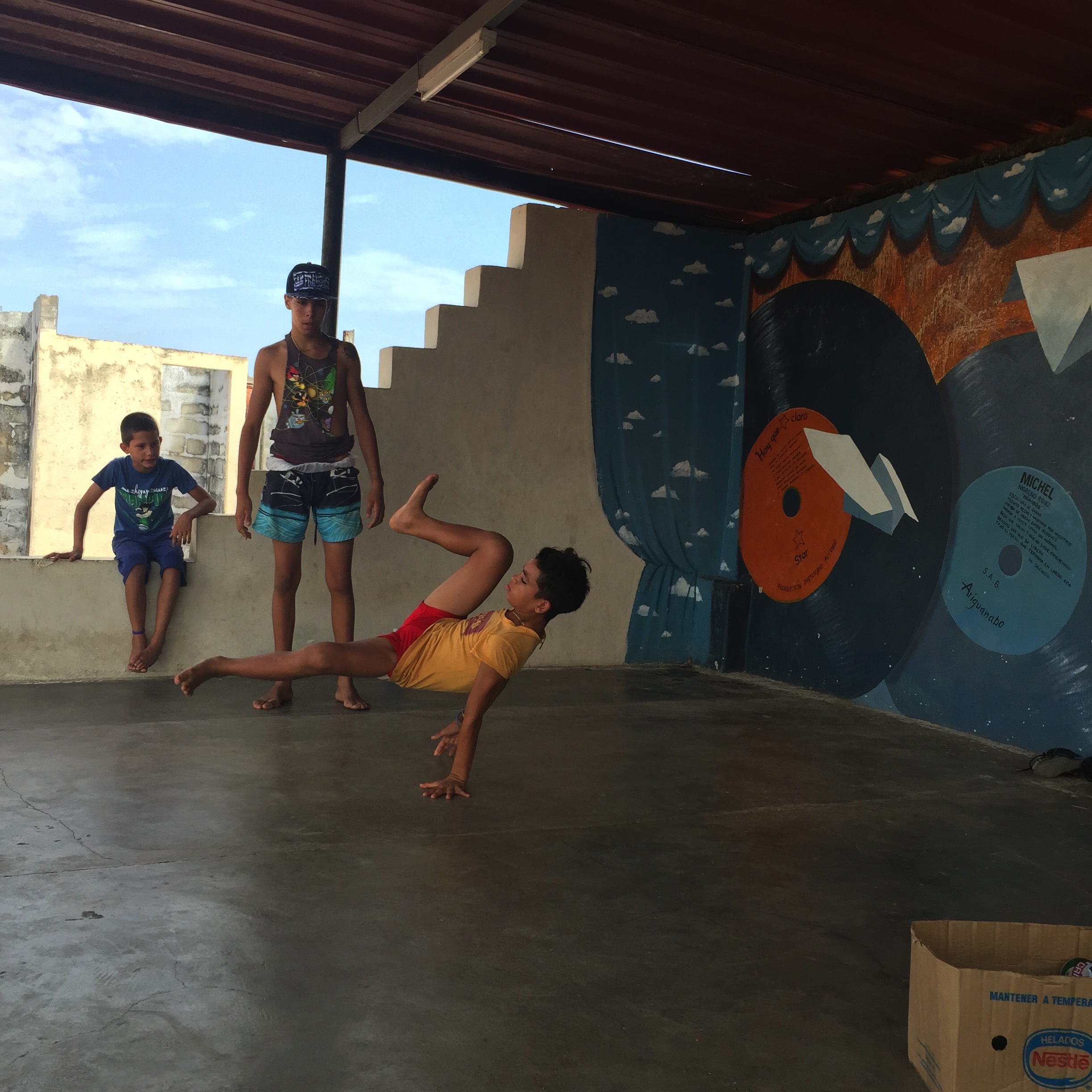 Breakdancers practice windmills in Artemisa