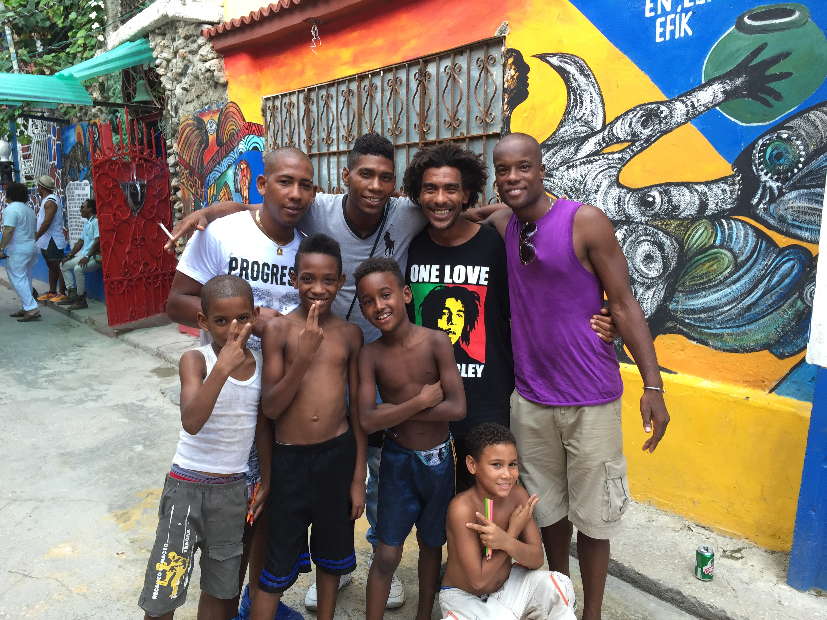 Poets, Rumberos, and kids hanging out at the famous Callejon de Hamel in Centro Habana